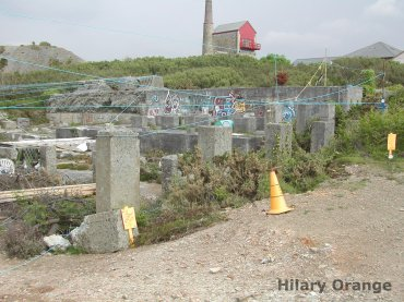Image of early 20th century stamps in St Agnes, Cornwall. The site has been re-used as a skate park and graffiti has been painted on some of the concrete remains